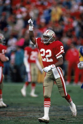 SAN FRANCISCO - JANUARY 14:  Cornerback Tim McKyer #22 of the San Francisco 49ers celebrates after a play during the NFC Championship game against the Los Angeles Rams at Candlestick Park on January 14, 1990 in San Francisco, California.  (Photo by George