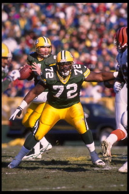3 Dec 1995:  Quarterback Brett Favre #4 of the Green Bay Packers drops back behind tackle Earl Dotson #72 during the game against the Cincinnati Bengals at Lambeau Field in Green Bay, Wisconsin.  The Packers defeated the Bengals 24-10.  Mandatory Credit: