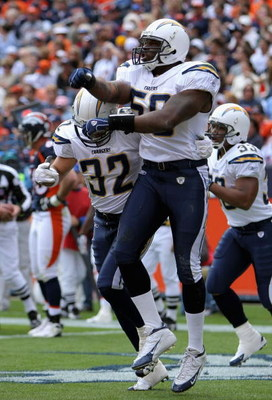 DENVER - OCTOBER 7:  Linebacker Brandon Siler #59 of the San Diego Chargers celebrates his 23 yard fumble recovery touchdown against the Denver Broncos during the first quarter of the game at Invesco Field at Mile High October 7, 2007 in Denver, Colorado.