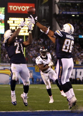 SAN DIEGO - DECEMBER 28:  Tight end Brandon Manumaleuna #86 of the San Diego Chargeover  LaDainian Tomlinson #21 and Ebenezer Ekuban #91 of the Denver Broncos during the second quarter of the NFL game at Qualcomm Stadium on December 28, 2008 in San Diego,