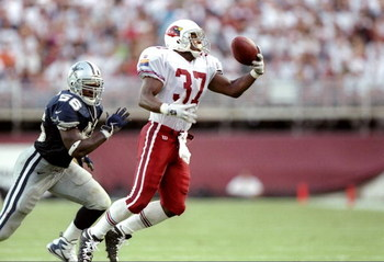 7 Sep 1997:  Running back Larry Centers #37 of the Arizona Cardinals catches a pass on the defense of Randall Godfrey of the Cowboys during the Cardinals 25-22 win over the Dallas Cowboys at Sun Devil Stadium in Tempe, Arizona. Mandatory Credit: Brian Bah