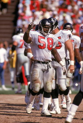 SAN FRANCISCO - SEPTEMBER 23:  Linebacker Jessie Tuggle #58 of the Atlanta Falcons on the field before a play during a game against the San Francisco 49ers at Candlestick Park on September 23, 1990 in San Francisco, California.  (Photo by George Rose/Gett