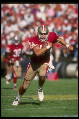 24 Oct 1993:  Tight end Brent Jones of the San Francisco 49ers runs with the ball during a game against the Phoenix Cardinals at Candlestick Park in San Francisco, California. The 49ers won the game, 28-14. Mandatory Credit: Otto Greule  /Allsport