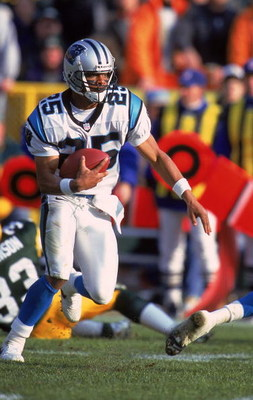 12 Dec 1999:  Eric Davis #25 of the Carolina Panthers moves with the ball during the game against the Green Bay Packers at Lambeau Field in Green Bay, Wisconsin. The Panthers defeated the Packers 33-31. Mandatory Credit: Jonathan Daniel  /Allsport
