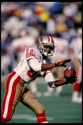 22 Oct 1995:  Wide receiver John Taylor of the San Francisco 49ers catches a pass during warm-ups prior to a 44-10 win over the St. Louis Rams at Busch Stadium in St. Louis, Missouri.  Mandatory Credit:  Brian Bahr/Allsport