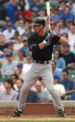 CHICAGO - MAY 6:  Left fielder Luis Gonzalez #20 of the Arizona Diamondbacks at bat during the game against the Chicago Cubs on May 6, 2004 at Wrigley Field in Chicago, Illinois. The Cubs defeated the Diamondbacks 11-3. (Photo by Jonathan Daniel/Getty Ima