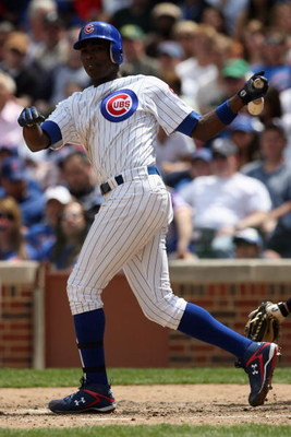CHICAGO - MAY 2:  Alfonso Soriano #12 of the Chicago Cubs runs to first against the Florida Marlins during the game on May 2, 2009 at Wrigley Field in Chicago, Illinois. (Photo by Jonathan Daniel/Getty Images)