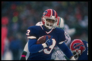 12 Jan 1991:  Wide receiver Andre Reed of the Buffalo Bills runs with the ball during a playoff game against the Miami Dolphins at Rich Stadium in Orchard Park, New York.  The Bills won the game, 44-34. Mandatory Credit: Rick Stewart  /Allsport