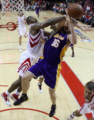 HOUSTON - MAY 08:  Guard Ron Artest #96 of the Houston Rockets commits a flagrant foul on Pau Gasol #16 of the Los Angeles Lakers in Game Three of the Western Conference Semifinals during the 2009 NBA Playoffs at Toyota Center on May 8, 2009 in Houston, T