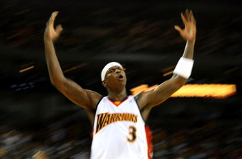 OAKLAND, CA - NOVEMBER 06:  Al Harrington #3 of the Golden State Warriors celebrates against the Cleveland Cavaliers during an NBA game on November 6, 2007 at Oracle Arena in Oakland, California. NOTE TO USER: User expressly acknowledges and agrees that,