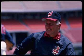1986:  All time great Atlanta Braves pitcher Phil Niekro, now a coach of the Cleveland Indians, talks with Reggie Jackson.   Mandatory Credit:  Steve Dunn/Allsport