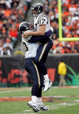 CINCINNATI - NOVEMBER 12:  Philip Rivers #17 hugs Shane Olivea #70 of the San Diego Chargers following a touchdown against the Cincinnati Bengals November 12, 2006 at Paul Brown Stadium in Cincinnati, Ohio.  (Photo by Jim McIsaac/Getty Images)