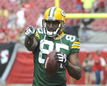 TAMPA, FL - SEPTEMBER 28: Wide receiver Greg Jennings #85 of the Green Bay Packers  warms up before play against the Tampa Bay Buccaneers at Raymond James Stadium on September 28, 2008 in Tampa, Florida.  (Photo by Al Messerschmidt/Getty Images)