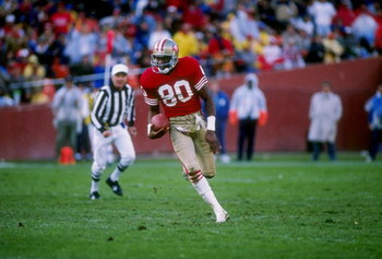 13 Oct 1988: Wide receiver Jerry Rice of the San Francisco 49ers runs down the field during a game against the Los Angeles Raiders at Candlestick Park in San Francisco, California. The Raiders won the game 9-3.