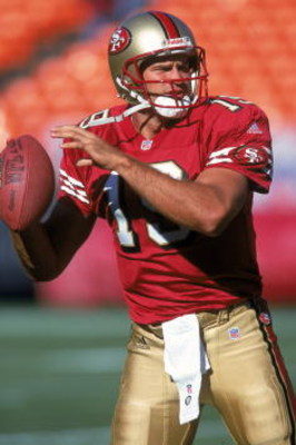 25 Aug 2000:  Quarterback Giovanni Carmazzi #19 of the San Francisco 49ers warms up his arm during practice before the game against the Denver Broncos at 3Com Park in San Francisco, California.  The Broncos defeated the 49ers 28 24.Mandatory Credit: Tom H