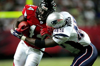 ATLANTA - AUGUST 11: Pierre Woods #45 of the New England Patriots tackles Fred McCrary #44 of the Atlanta Falcons during their preseason game on August 11, 2006 at the Georgia Dome in Atlanta, Georgia. (Photo By Streeter Lecka/Getty Images)
