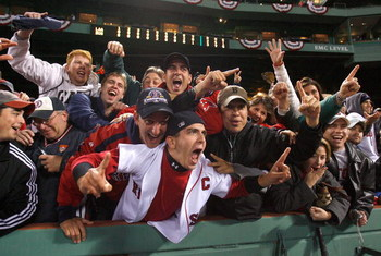BOSTON - OCTOBER 6: Fans of the Boston Red Sox celebrate after defeating the Los Angeles Angels of Anaheim for the American League Division Series at Fenway Park on October 6, 2008 in Boston, Massachusetts. (Photo by Jim Rogash/Getty Images)
