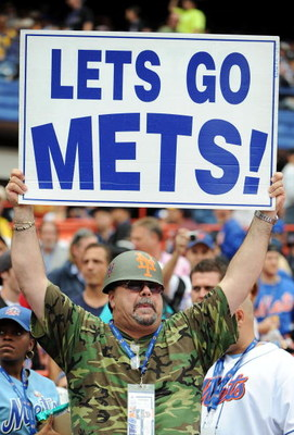 NEW YORK - SEPTEMBER 28:  Fans hold a signs before the start of the last regular season baseball game ever played in Shea Stadium featuring the New York Mets and the Florida Marlins on September 28, 2008 in the Flushing neighborhood of the Queens borough