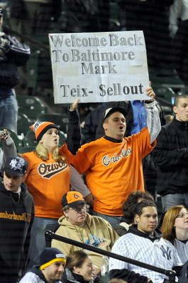 BALTIMORE - APRIL 8:  Fans hold up a sign during the game between the New York Yankees and the Baltimore Orioles at Camden Yards April 8, 2009 in Baltimore, Maryland.  (Photo by Greg Fiume/Getty Images)