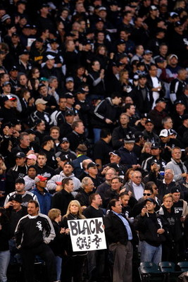 CHICAGO - SEPTEMBER 30:  A fan of the Chicago White Sox holds up a sign which reads 'Black out' in reference to all the fans wearing black for the game against the Minnesota Twins during the American League Central Division Tiebreaker game at U.S. Cellula