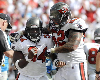 TAMPA, FL - OCTOBER 12: Running back Earnest Graham #34 of  the Tampa Bay Buccaneers celebrates a touchdown with center Jeff Faine #52 against the Carolina Panthers at Raymond James Stadium on October 12, 2008 in Tampa, Florida.  (Photo by Al Messerschmid