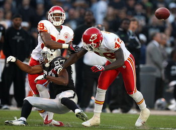 OAKLAND, CA - NOVEMBER 30: Thomas Gafford #48 and Brandon Carr #39 of the Kansas City Chiefs hits Ashley Lelie #87 of the Oakland Raiders on a pass attempt during an NFL game on November 30, 2008 at the Oakland-Alameda County Coliseum in Oakland, Californ