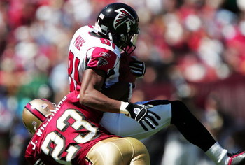 SAN FRANCISCO - SEPTEMBER 12:  Peerless Price #81 of the Atlanta Falcons catches a pass over Jimmy Williams #23 of the San Francisco 49ers on September 12, 2004 at 3Com Park in San Francisco, California.  (Photo by Jed Jacobsohn/Getty Images)