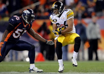 DENVER - OCTOBER 21:  Hines Ward #86 of the Pittsburgh Steelers makes a reception as D.J. Williams #55 of the Denver Broncos defends at Invesco Field at Mile High on October 21, 2007 in Denver, Colorado. The Broncos defeated the Steelers 31-28.  (Photo by