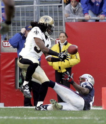 FOXBORO, MA - NOVEMBER 20:  Cornerback Mike McKenzie #34 of the New Orleans Saints breaks up a pass intended for wide receiver Andre Davis #18 of the New England Patriots on November 20, 2005 at Gillette Stadium in Foxboro, Massachusetts. The Patriots def