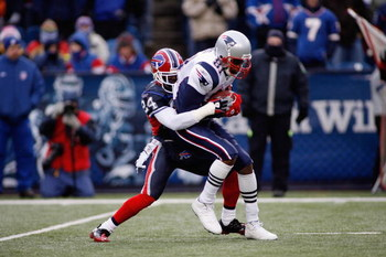 ORCHARD PARK, NY - DECEMBER 28:  Terrence McGee #24 of the Buffalo Bills tackles Randy Moss #81 of the New England Patriots on December 28, 2008 at Ralph Wilson Stadium in Orchard Park, New York. (Photo by Rick Stewart/Getty Images)