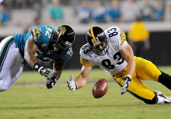 JACKSONVILLE, FL - OCTOBER 05:  Daryl Smith #52 of the Jacksonville Jaguars and Heath Miller #83 of the Pittsburgh Steelers scramble for a loose ball at Jacksonville Municipal Stadium on October 5, 2008 in Jacksonville, Florida.  (Photo by Sam Greenwood/G