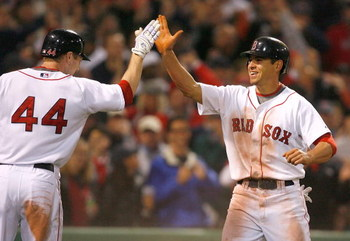 BOSTON - APRIL 26: Jacoby Ellsbury #46 of the Boston Red Sox steals home and celebrates with teammate Jason Bay #44 against the New York Yankees at Fenway Park April 26, 2009 in Boston, Massachusetts. (Photo by Jim Rogash/Getty Images)