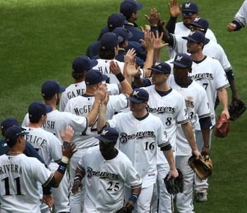 MILWAUKEE - MAY 14: Members of the Milwaukee Brewers including Mike Cameron #25, Chris Duffy #16, Ryan Braun #8 and Rickie Weeks #23 celebrate a win over the Florida Marlins on May 14, 2009 at Miller Park in Milwaukee, Wisconsin. The Brewers defeated the