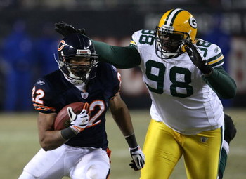 CHICAGO - DECEMBER 22: Matt Forte #22 of the Chicago Bears runs past Alfred Malone #98 of the Green Bay Packers on December 22, 2008 at Soldier Field in Chicago, Illinois. The Bears defeated the Packers 20-17 in overtime. (Photo by Jonathan Daniel/Getty I