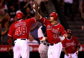 ANAHEIM, CA - MAY 13:  Mike Napoli #44 of the Los Angeles Angels of Anaheim is greeted at home plate by Torii Hunter #48 as both score on Napoli's three run home run in the third inning against the Boston Red Sox on May 13, 2009 at Angel Stadium in Anahei