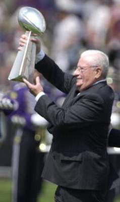 9 Sep 2001: Art Modell, owner of the Baltimore Ravens presents the superbowl trophy to the crowd during pre-game festivities at the game against the Chicago Bears at PSINet Stadium in Baltimore, Maryland.  The Ravens won 17-6. DIGITAL IMAGE. Mandatory Cre