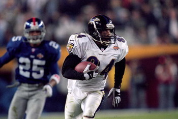 28 Jan 2001:  Jermaine Lewis #84 of the Baltimore Ravens runs with the ball for an 84 yard touchdown return during the Super Bowl XXXV Game against the New York Giants at the Raymond James Stadium in Tampa, Florida. The Ravens defeated the Giants 34-7. Ma