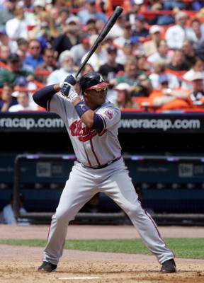 NEW YORK - APRIL 19:  Andruw Jones #25 of the Atlanta Braves bats against the New York Mets on April 19, 2006 at Shea Stadium in the Flushing neighborhood of the Queens borough of New York City. The Braves defeated the Mets 2-1.  (Photo by Jim McIsaac/Get