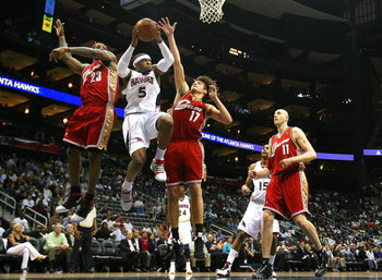 ATLANTA - MAY 11:  Josh Smith #5 of the Atlanta Hawks drives to the basket against LeBron James #23 and Anderson Varejao #17 of the Cleveland Cavaliers during Game Four of the Eastern Conference Semifinals during the 2009 NBA Playoffs at Philips Arena on
