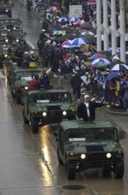 30 Jan 2001:  Super Bowl XXXV champions Baltimore Ravens travel in Hummer's down Pratt Street along the Inner Harbor during their victory parade through the rain soaked streets of downtown Baltimore, Maryland. Digital File Mandatory Credit: Doug Pensinger