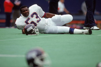 UNDATED:  Linebacker Harry Carson #53 of the New York Giants takes a breather as he reclines on the field prior to a game circa 1980's. Carson played for the Giants from 1976-88. (Photo by T.G. Higgins/Getty Images)