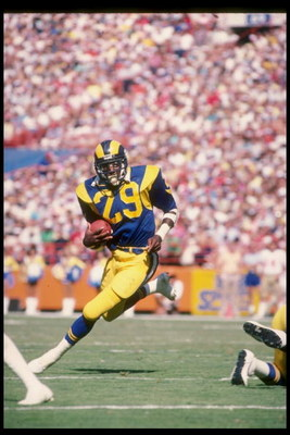 1986:  Running back Eric Dickerson of the Los Angeles Rams runs down the field during a game at Anaheim Stadium in Anaheim, California.  Mandatory Credit: Mike Powell  /Allsport