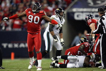 HOUSTON - DECEMBER 01:  Defensive tackle Mario Williams #90 of the Houston Texans reacts after making a quarterback sack against David Garrard #9 of the Jacksonville Jaguars at Reliant Stadium on December 1, 2008 in Houston, Texas.  (Photo by Ronald Marti