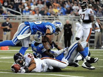 DETROIT - OCTOBER 05:  Matt Forte #22 of the Chicago Bears is awarded a touhdown as he appears to have been stopped by Dwight Smith #26 and Ernie Sims #50 of the Detroit Lions on the goaline for a 10-0 lead during the aecond quarter at Ford Field on Octob