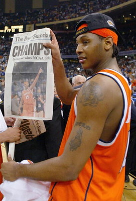 NEW ORLEANS - APRIL 7:  Carmelo Anthony #15 of Syracuse holds up tommorows paper which declares the Orangeman national champs after he and his team defeated Kansas 81-78 during the championship game of the NCAA Men's Final Four Tournament on April 7, 2003