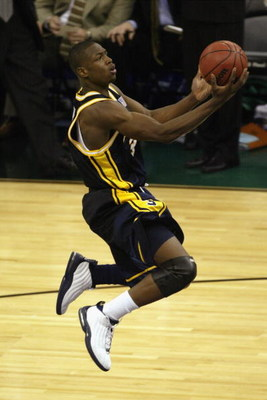 NEW ORLEANS - APRIL 5:  Dwyane Wade #3 of Marquette University Golden Eagles drives to the basket during the semifinal round of the NCAA Final Four Tournament against the University of Kansas Jayhawks at the Louisiana Superdome on April 5, 2003 in New Orl