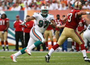 MIAMI - DECEMBER 14:  Defensive end Phillip Merling #97 of the Miami Dolphins chases quarterback Shaun Hill #13 of the San Francisco 49ers at Dolphin Stadium on December 14, 2008 in Miami, Florida. The Dolphins defeated the 49ers 14-9.  (Photo by Doug Ben