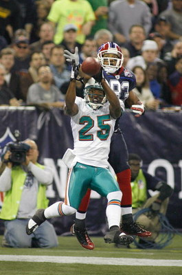 TORONTO, ON - DECEMBER 07: Will Allen #25 of the Miami Dolphins intercepts a pass in the end zone intended for Lee Evans #83 of the Buffalo Bills on December 7, 2008  at Rogers Centre in Toronto, Ontario, Canada. The Dolphins won 16-3.  (Photo by Rick Ste