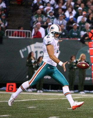 EAST RUTHERFORD, NJ - DECEMBER 28:  Brandon Fields #2 of The Miami Dolphins punts the ball against The New York Jets during their game on December 28, 2008 at Giants Stadium in East Rutherford, New Jersey.  (Photo by Al Bello/Getty Images)