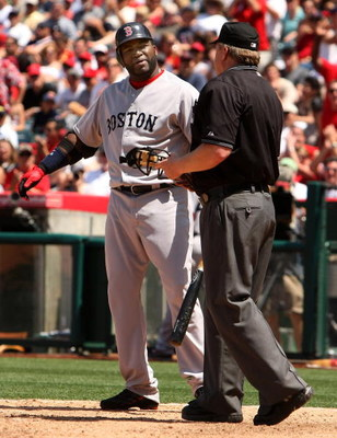 ANAHEIM, CA - MAY 14:  David Ortiz #34 of the Boston Red Sox complains to home plate umpire Bill Miller after bieng called out on strikes in the sixth inning of the game with the Los Angeles Angels of Anaheim on May 14, 2009 at Angel Stadium in Anaheim, C